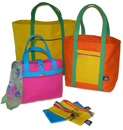Three totes shown in various colors.  A couple of Accessories round out the picture.
